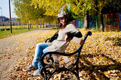 Girl sitting in the park Royalty Free Stock Photo