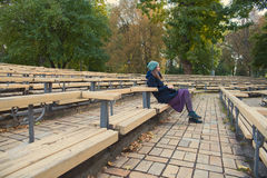 Girl sitting in the park Royalty Free Stock Image