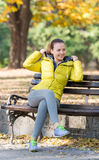 Girl sitting on a park bench Royalty Free Stock Photo