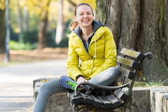 Girl sitting on a park bench Royalty Free Stock Photos