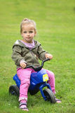 Girl sitting in the park on a motorbike Royalty Free Stock Photography
