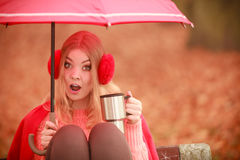 Girl sitting in park with umbrella Royalty Free Stock Images