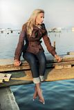 Girl sitting on a pier Royalty Free Stock Photos