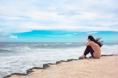 The girl sitting on a pier Royalty Free Stock Photo
