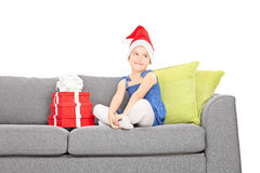 Girl sitting by a pile of Christmas presents Royalty Free Stock Photos
