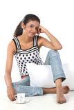 girl sitting with pillow and cup of coffee Royalty Free Stock Photo