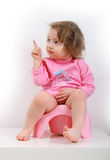 Girl sitting on a pink pot Stock Photos