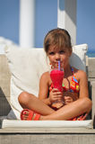 Girl sitting in the pool and drinking cocktails Royalty Free Stock Images