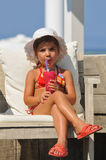 girl sitting in the pool and drinking cocktails Stock Photo