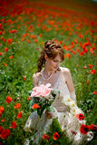Girl sitting among poppies Royalty Free Stock Photography