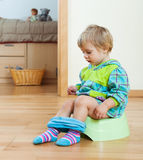 Girl sitting on potty Royalty Free Stock Photos