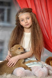 Girl sitting with a puppy in her arms Royalty Free Stock Photography