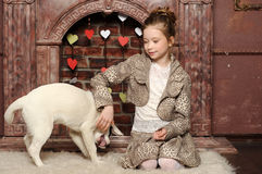 Girl sitting  with a puppy in her arms Stock Photography
