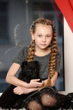 Girl sitting  with a puppy in her arms Stock Photos