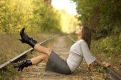 Girl sitting on the rails Stock Photo