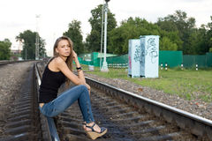 Girl sitting on rails Royalty Free Stock Photo
