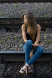 Girl sitting on rails Royalty Free Stock Image