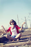 A girl sitting on the railway Royalty Free Stock Photography