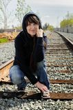 Girl sitting in the railway Stock Photography