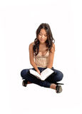 Girl sitting  and reading. Royalty Free Stock Image