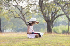 Girl sitting reading a book. Stock Photos