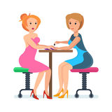 Girl, sitting at reception with specialist in nail service. Royalty Free Stock Photo