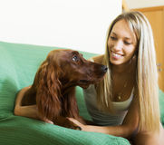 Girl sitting with red Irish setter Royalty Free Stock Photo