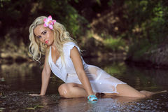 Girl sitting in the river of jungle. Stock Image