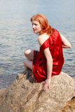 Girl sitting on the rock Royalty Free Stock Photography