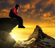Girl sitting on a rock Stock Photography