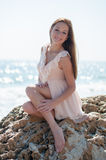 Girl sitting on a rock Royalty Free Stock Photos