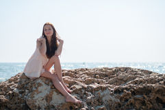 Girl sitting on a rock Royalty Free Stock Photography