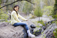 Girl sitting on rock cliff edge Royalty Free Stock Photography