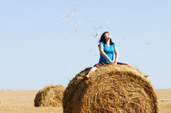 Girl sitting on roll Royalty Free Stock Photos