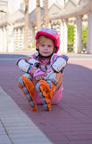 Girl sitting on roller skates Royalty Free Stock Photos