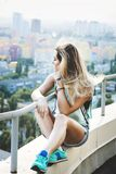 Girl sitting on the roof Stock Photos