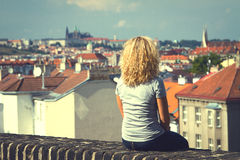 Girl sitting on the roof of a house Royalty Free Stock Photos