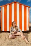 Girl beach sun sand hut, De Panne, Belgium royalty free stock photo