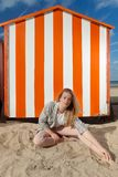Girl sitting sun sand hut, De Panne, Belgium stock photography
