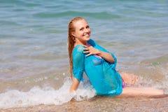 Girl sitting on the seashore Royalty Free Stock Photos