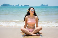 Girl sitting by the seaside Stock Images