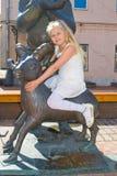 Girl sitting on the Sheep Stock Photos