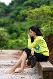 Girl sitting on side bench Stock Images