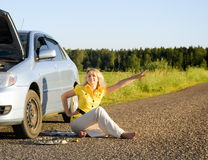 Girl sitting and signaling problems with the car royalty free stock photography