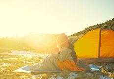 Girl sitting in a sleeping bag. Stock Photography