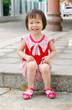 Girl sitting and smiling Royalty Free Stock Photos
