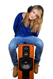 The girl sitting on the speaker Royalty Free Stock Images