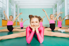 Girl sitting in splits during gymnastics class Stock Image