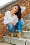 Girl sitting on the staircase with a stone balustrade Royalty Free Stock Photo