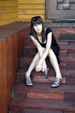 Girl sitting on stairs. Outdoor Royalty Free Stock Photography